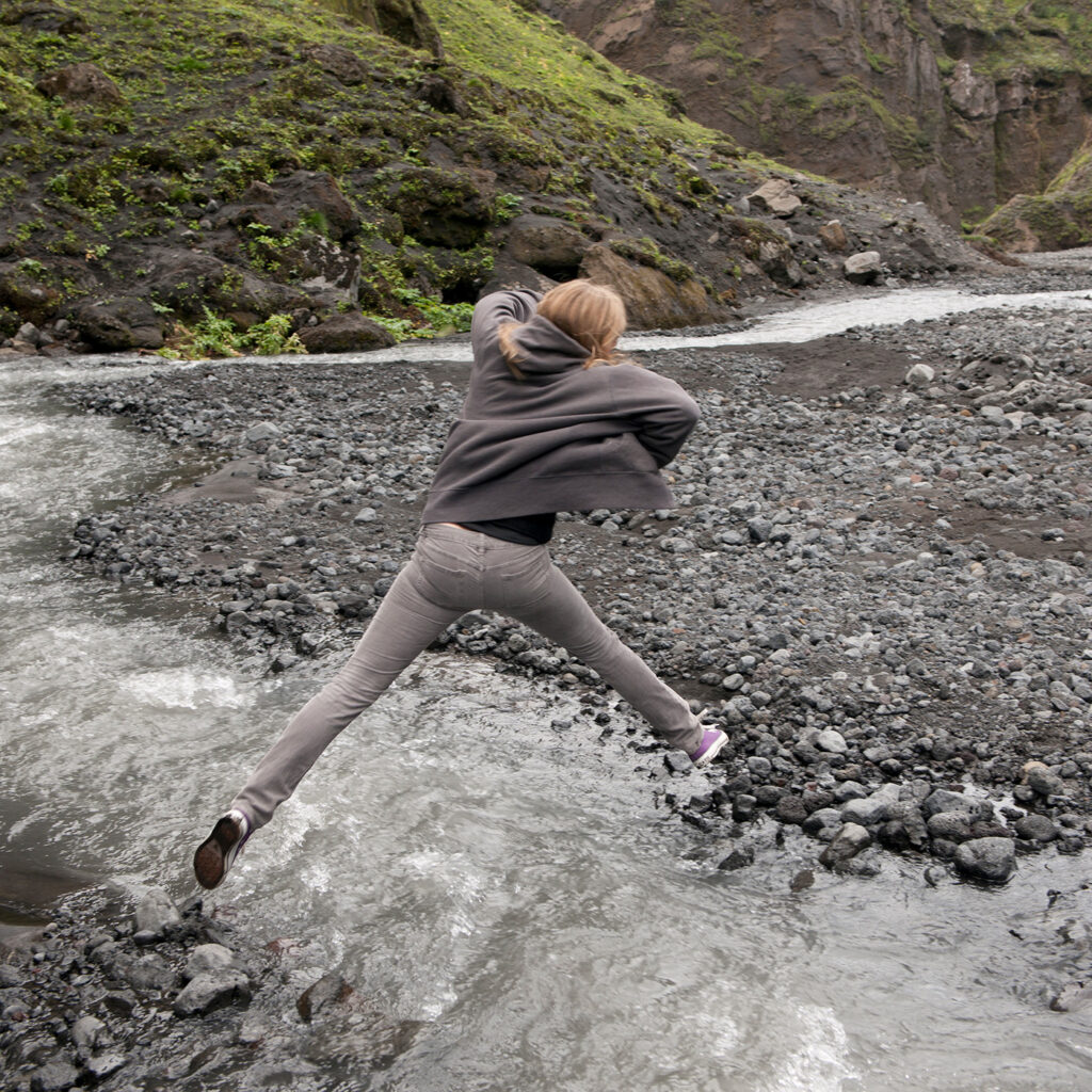 Sensory integration: Girl jumps a stream of water using propioception sense